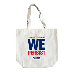 Natural colored tote with the phrase NEVER THE LESS WE PERSIST in red and navy.
