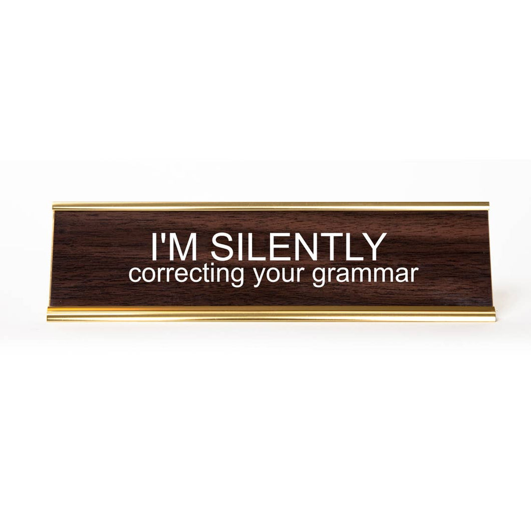 Silently Correcting Your Grammar Deskplate