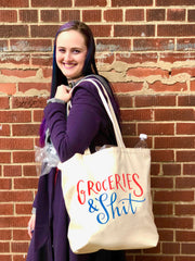 Model Carrying Canvas Tote Bag Full of Groceries
