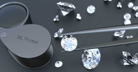 Picture of loupe and diamonds