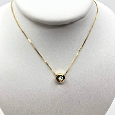 Bezel Set Yellow Gold and Diamond Pendant