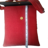 Red crossbody bag with adjustable straps