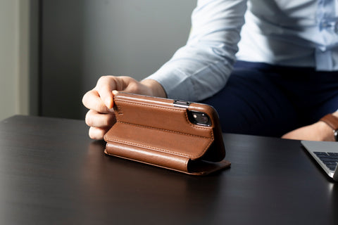 man with a leather iPhone case