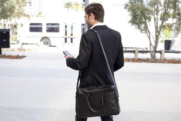 Man walking with a leather bag