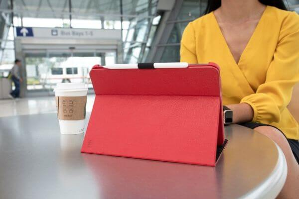A woman with an iPad at a train station