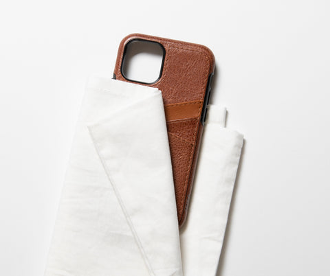 white cloth on brown leather cell phone case