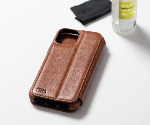 brown leather cell phone case on white table