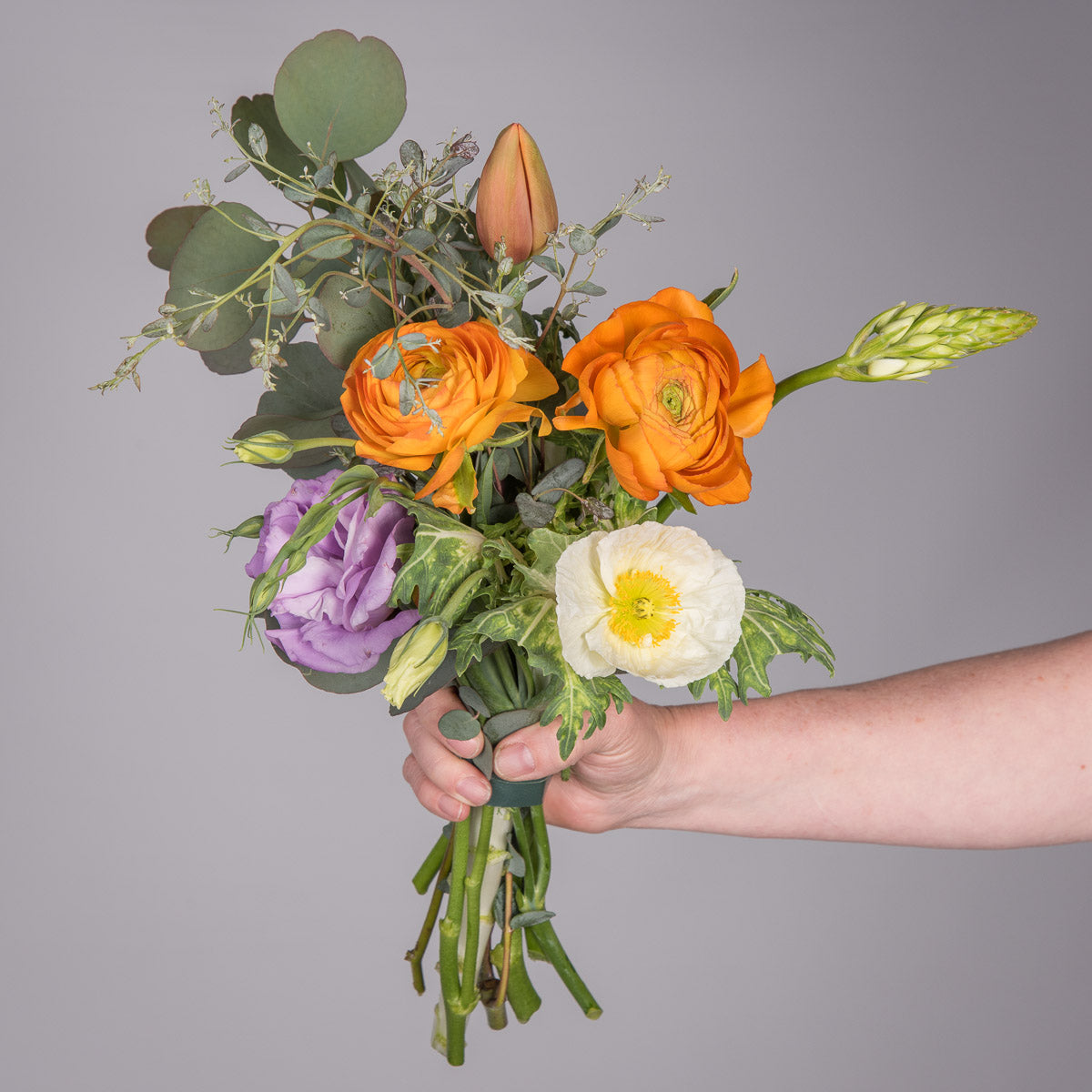 Shop mossflower seasonal responsibly sourced flowers fresh cut flower bouquet with orange ranunculus orange kumquats lavender lisianthus pink poppies izmirmasajfo Image collections
