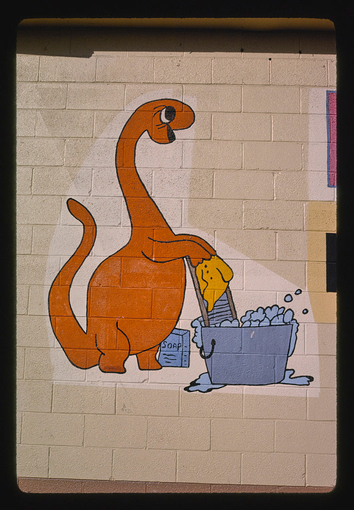 8 x 12 Photo of Holiday Laundromat facade sign, dinosaur detail, Route 40, Vernal, Utah 1991 Margolies, John 25a