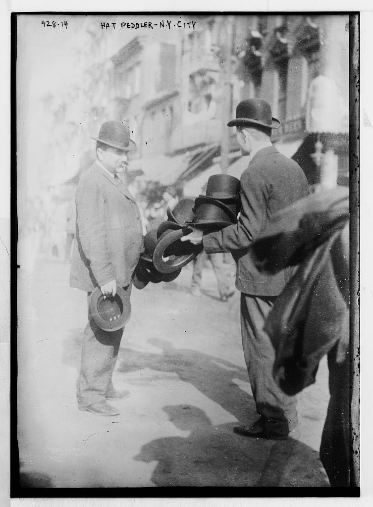 8 x 10 Photo of Hat Peddler and prospective buyer, on sidewalk, New York 1890-1920 G. Bain Collection 54a