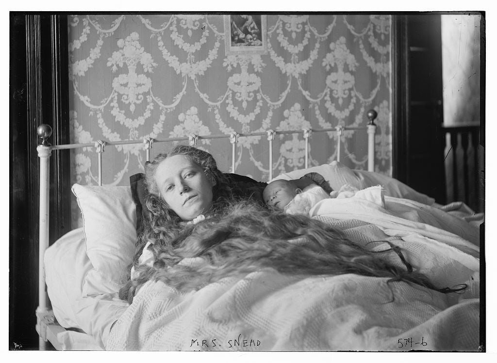 8 x 10 Photo of Mrs. Ocey Snead, in bed, baby in arms 1890-1920 G. Bain Collection 99a