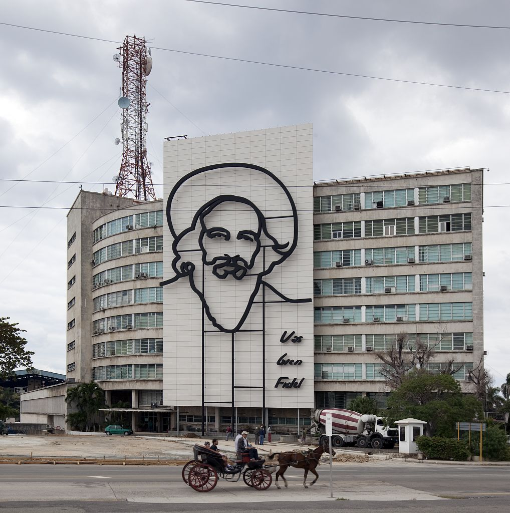 18 x 24 Photograph reprinted on fine art canvas  of Camilo Cienfuegos Fidel Castro's right-hand man and confident during the revolution is outlined in iron on the front fa?ade of this building on Revolution Square Havana Cub