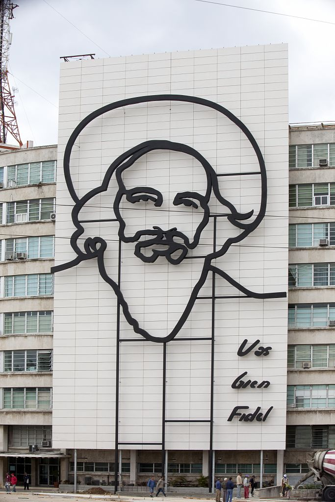 18 x 24 Photograph reprinted on fine art canvas  of Camilo Cienfuegos Fidel Castro's right-hand man and confident during the revolution is outlined in iron on the front fa?ade of this building on Revolution Square in Havana