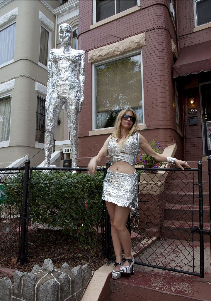 18 x 24 Photograph reprinted on fine art canvas  of An artist wraps herself in tinfoil and stands next to her art in an historic neighborhood in Washington D.C. r91 2010 by Highsmith, Carol M.,