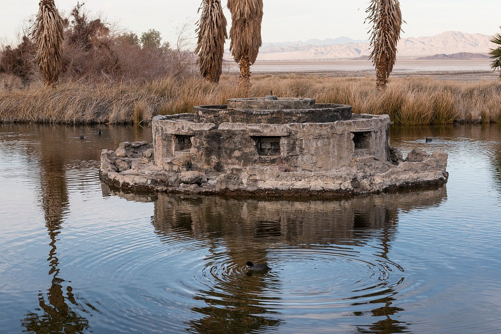 "18 x 24 Photograph reprinted on fine art canvas  of The non-functioning fountain within an artificial pond called ""Lake Tuendae"" at the Desert Studies Center at the tiny settlement of Zzyzx near Baker and adjacent to the Moj"