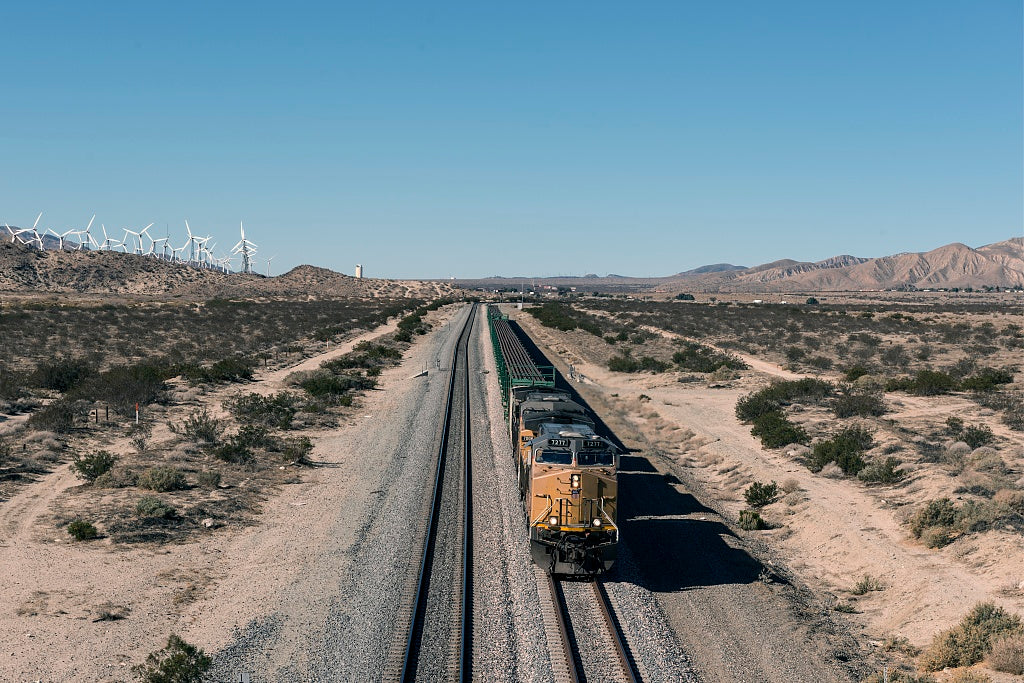 18 x 24 Photograph reprinted on fine art canvas  of A long freight train approaches between a wind-turbine farm and desert land outside the town of Cabazon in Riverside County California r46 2013 by Highsmith, Carol M.