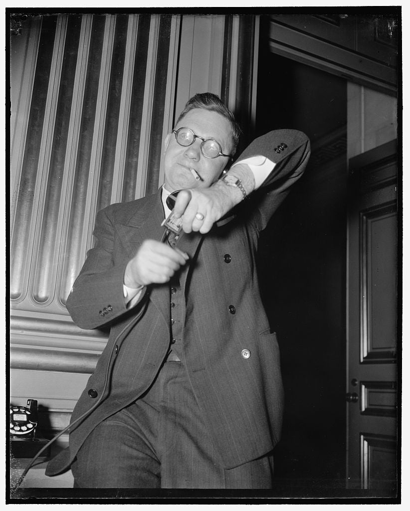8 x 10 Reprinted Old Photo of George L. Googe, Atlanta, Ga., Southern Representative Of Af Of L, Making A Long Distance Call To New Orleans And Lighting A Cigarette At The Same 1939 Harris & Ewing 19a