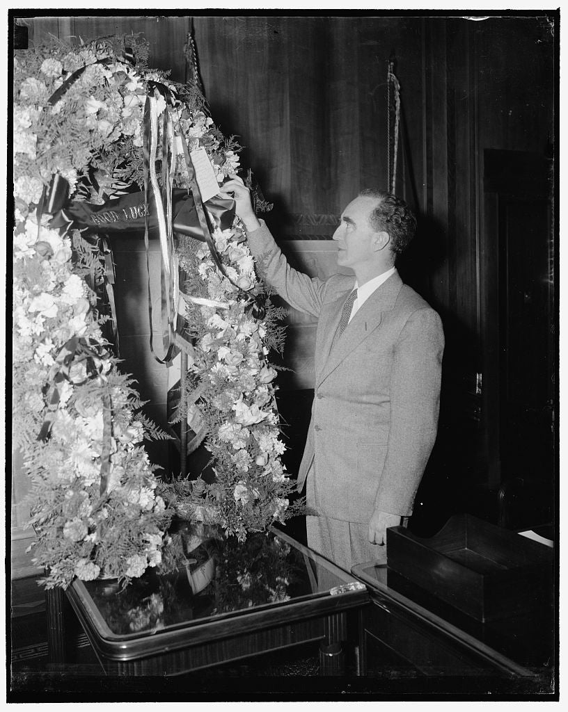 8 x 10 Reprinted Old Photo of New Attorney General Admires Floral Horseshoe, A Gift Of Michigan Congressionals. Washington, D.C., Jan. 3. Arriving At The Department Of Justice  1937 Harris & Ewing 04a