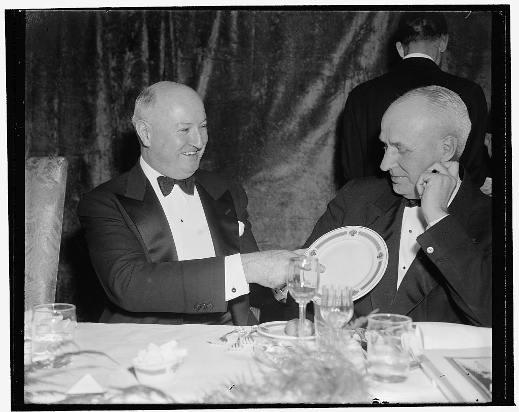 8 x 10 Reprinted Old Photo of Here It Is: Price $100. Washington, D.C., Jan. 7. 'this' Says Postmaster General James A. Farley, 'Is The $100 Jackson Day Dinner Plate.' O. Max G 1937 Harris & Ewing 57a