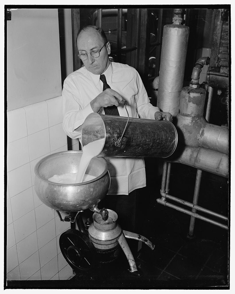 8 x 10 Reprinted Old Photo of Method For Preserving Cream. To Remove The Salt, The Cream Is Diluted With Fresh Skim Milk And Run Through A Cream Separator. The Salt Is Removed  1939 Harris & Ewing 24a