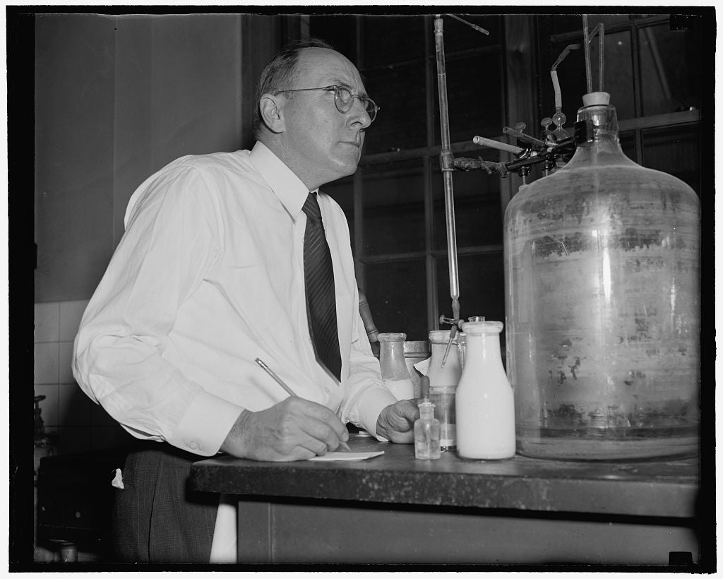 8 x 10 Reprinted Old Photo of Owen E. Williams Method For Preserving Cream. 4. Mr. Williams Then Puts The Cream Through A Test To Determine Its Acidity Contents, 1- 26-39 1937 Harris & Ewing 26a