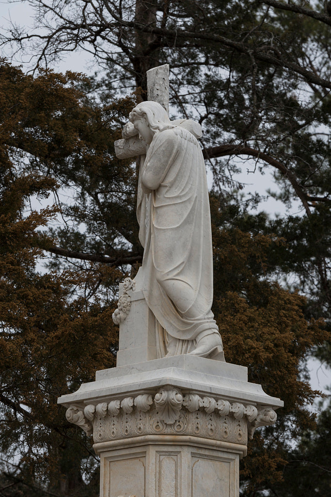 18 x 24 Photograph reprinted on fine art canvas  of Statues of Jesus some say this is an unidentified angel are not unusual in American cemeteries. Nor are monuments like this one at the grave of small-town businessmen. What