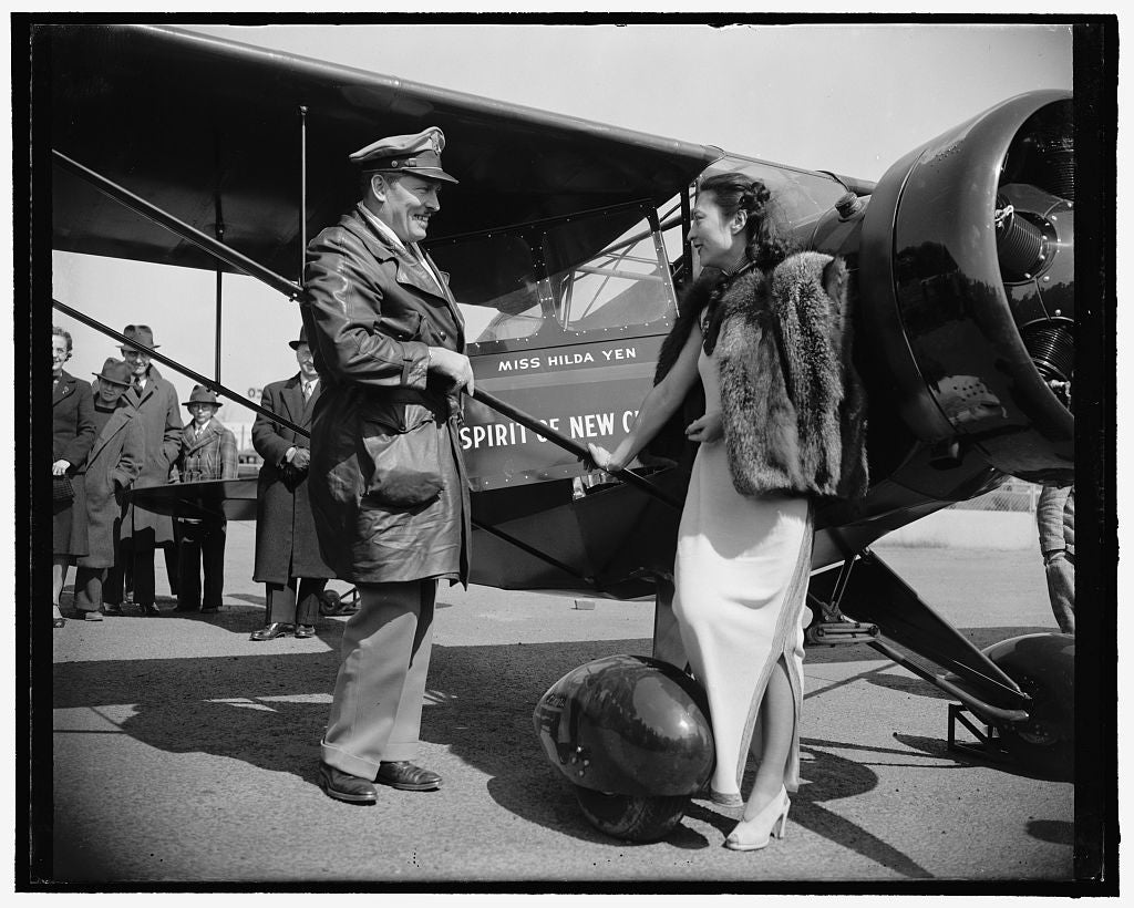 8 x 10 Reprinted Old Photo of Chinese Aviatrix Receives Gift Of New Plane From Col. Roscoe Turner. Washington, D.C., April 3. Col. Roscoe Turner, Winner Of Speed Trophies In Th 1939 Harris & Ewing 01a