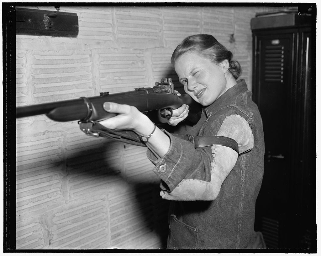 8 x 10 Reprinted Old Photo of Co-Ed Crowned Queen Of Rifle Shooters. Washington, D.C., April 6. Jean Yocum, George Washington University Co-Ed, Has Won The Women's Individual I 1939 Harris & Ewing 27a