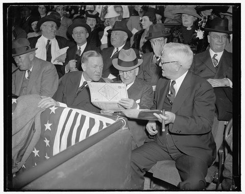 8 x 10 Reprinted Old Photo of Who's Going To Pitch  Washington, D.C., April 21. Like Old Line Fans That They Are, The Nation's No.1 Baseball Fans Look Over The Program First Th 1938 Harris & Ewing 27a