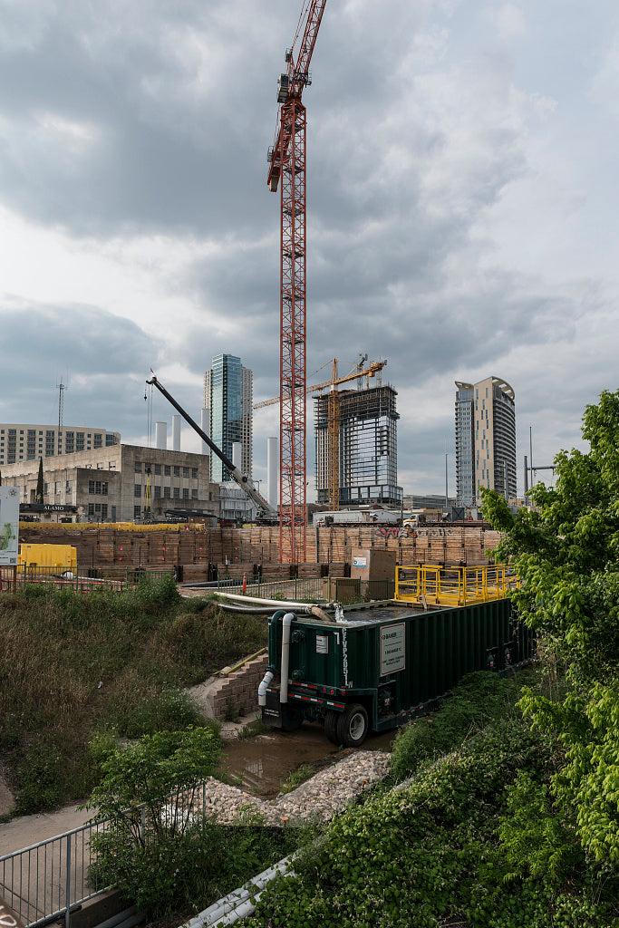 18 x 24 Photograph reprinted on fine art canvas  of Construction of a high-rise condominum behind the central core of the old City of Austin Seaholm Power Plant in Austin Texas r17 41748 by Highsmith, Carol M.