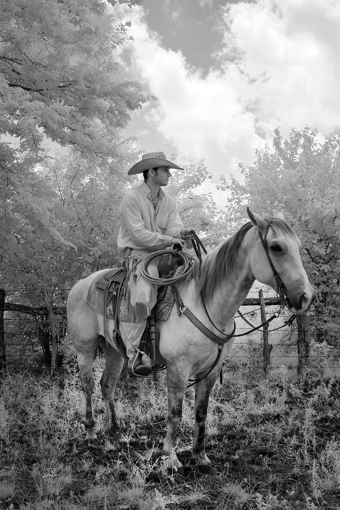 18 x 24 Photograph reprinted on fine art canvas  of Cowhand Robert Vaughn aboard his horse Dunnie at the 1 800-acre Lonesome Pine Ranch a working cattle ranch that is part of the Texas Ranch Life ranch resort near Chappell H
