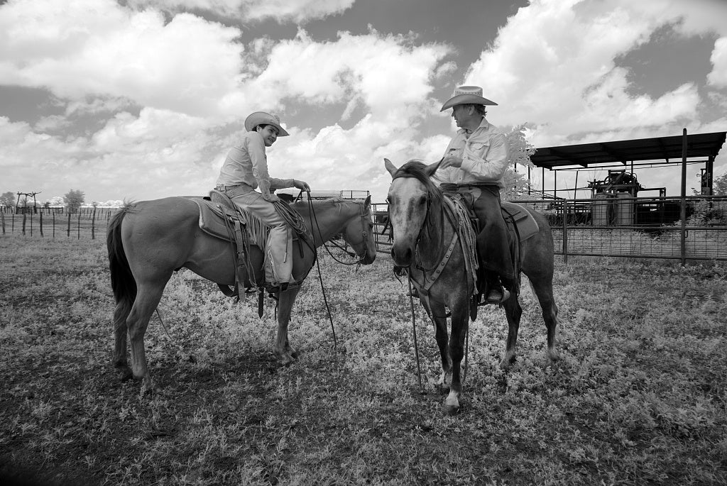 18 x 24 Photograph reprinted on fine art canvas  of Cowhand Lars Hollis left and John Elick owner of the 1 800-acre Lonesome Pine Ranch a working cattle ranch that is part of the Texas Ranch Life ranch resort near Chappell H