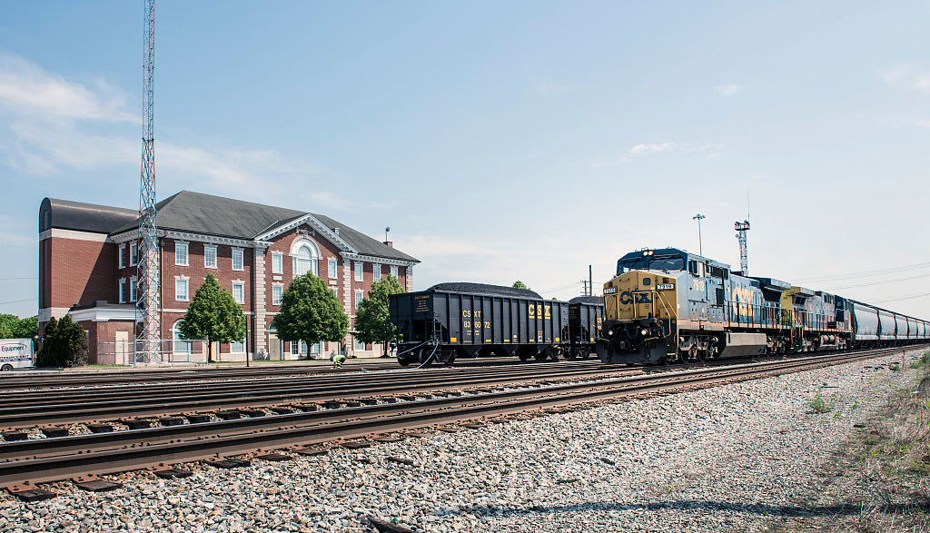 18 x 24 Photograph reprinted on fine art canvas  of A diesel locomotive and freight cars and a line of hoppers filled with coal sit behind the CSX train station in Huntington West Virginia r07 42131 by Highsmith, Carol M.