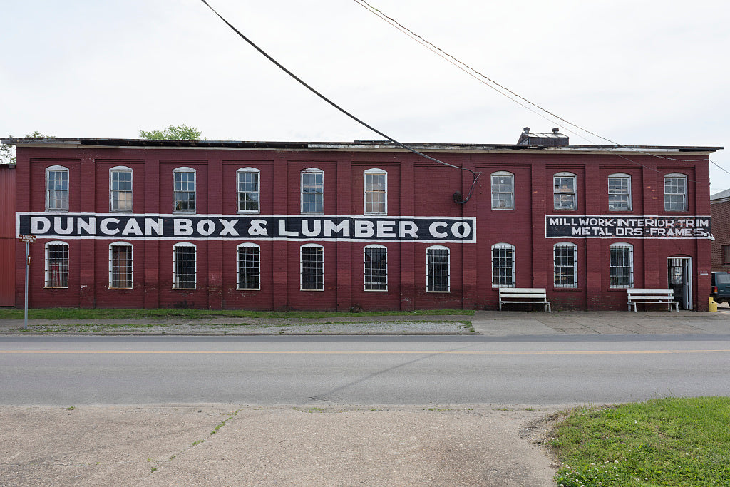 "18 x 24 Photograph reprinted on fine art canvas  of Duncan Box & Lumber Co. one of several vintage commercial buildings in the Old Central City neighborhood of Huntington West Virginia which its promoters call the ""Antique C"