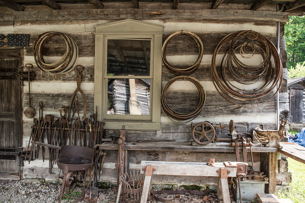 18 x 24 Photograph reprinted on fine art canvas  of Various implements outside a blacksmith shop at Heritage Farm Museum and Village in Harveytown West Virginia just south of downtown Huntington r50 42131 by Highsmith, Carol