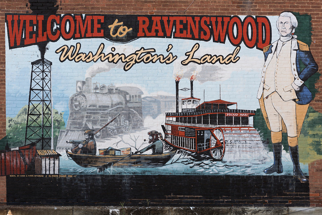 "18 x 24 Photograph reprinted on fine art canvas  of The ""Welcome to Ravenswood"" mural in Ravenswood West Virginia. The George Washington reference pertains to the nation's first president's ownership of lands in the area whi"