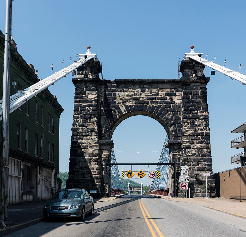 18 x 24 Photograph reprinted on fine art canvas  of The eastern or downtown-Wheeling arched entryway to the Wheeling Suspension Bridge also known as the Stone Arch Bridge which was the largest suspension bridge in the world
