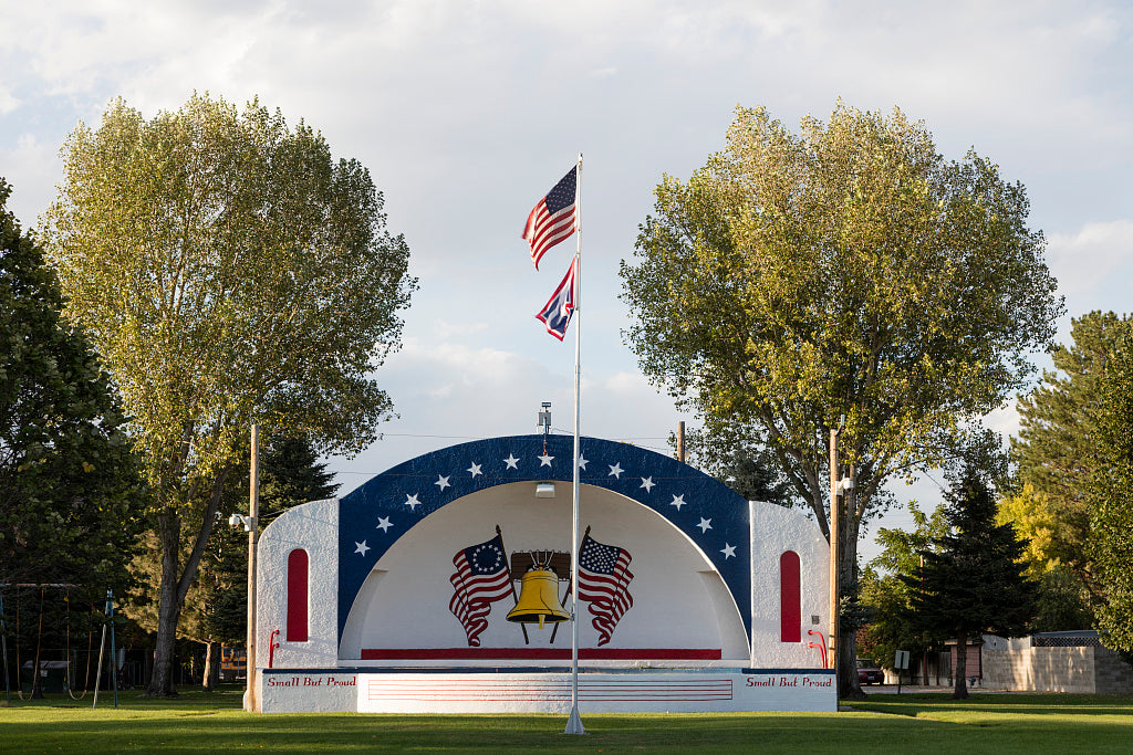 18 x 24 Photograph reprinted on fine art canvas  of Patriotically painted bandshell in Lingle Wyoming's Whipple Park named after Ivan Whipple a lineman employed by Wyrulec Company an early distributor of electricity in south