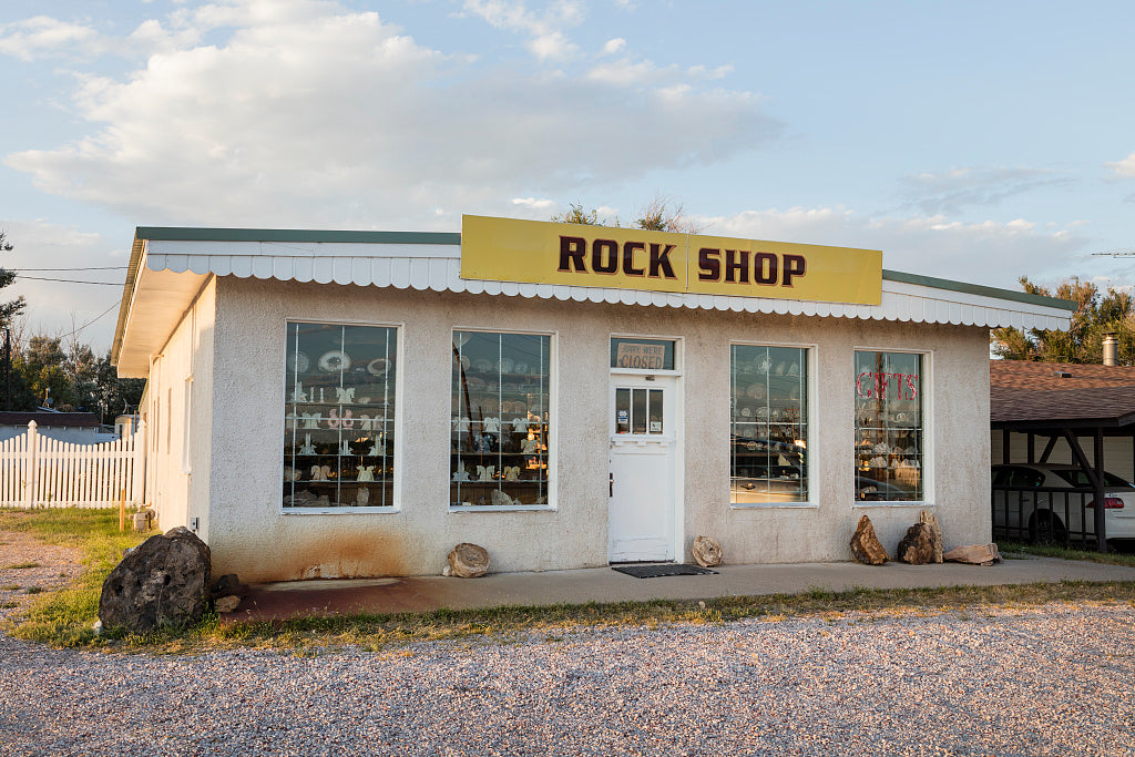 18 x 24 Photograph reprinted on fine art canvas  of A rock shop in Torrington Wyoming. As one can see through its windows this is not a rock-'n'-roll emporium but a true rock store of the type that was once a common tourist