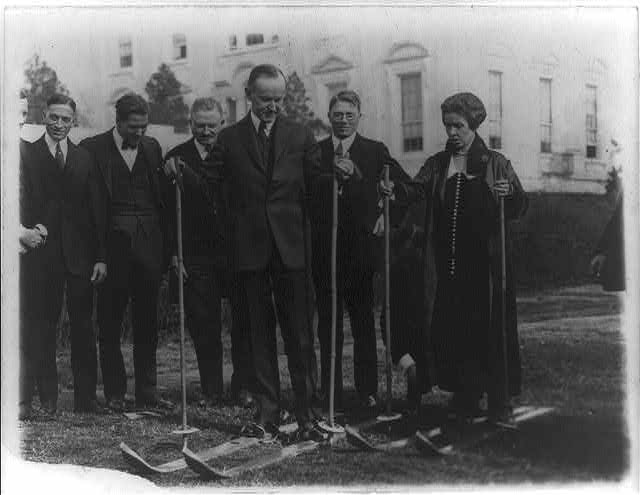 8 x 10 Reprinted Old Photo of President & Mrs. Coolidge on skis on the White House lawn during visit of members of the National Ski Assn., Dec. 18, 1924 1924 National Photo Co  17a