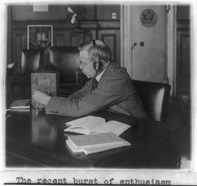 16 x 20 Reprinted Old Photo of [Government official seated at his desk wearing head phones and tuning small radio] 1922 National Photo Co  12a