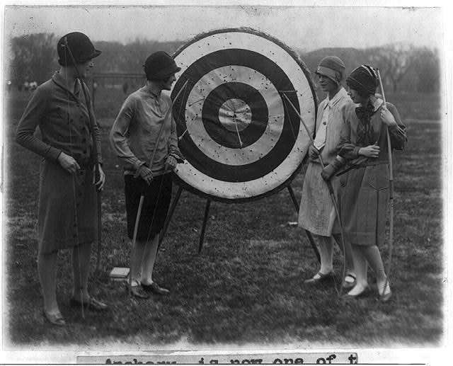 8 x 10 Reprinted Old Photo of 4 girls of Marjorie Webster school examining archery target - Louise Walraven, Imogene Koonce, Helyn Braskie and Helen Ackerman 1926 National Photo Co  45a
