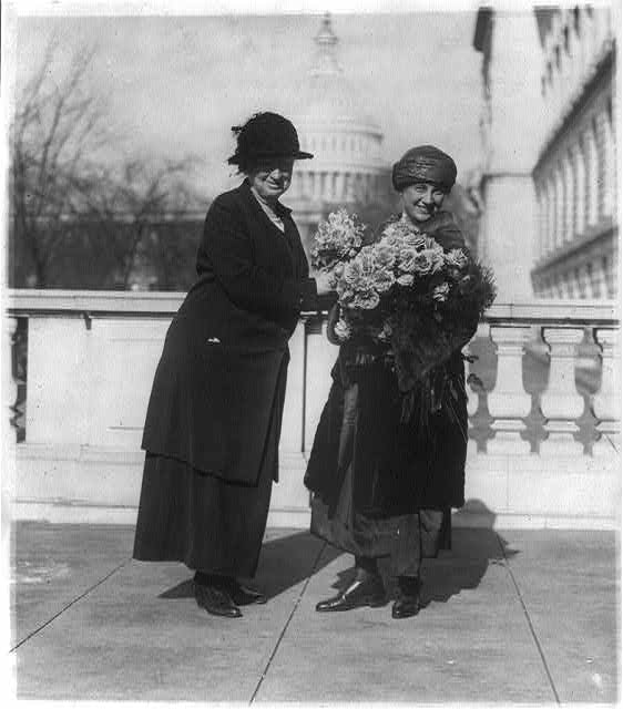 8 x 10 Reprinted Old Photo of Miss Alice Robertson of Okla. presenting her new collegue [sic], Mrs. Winifred Mason Huck with flowers on the latter's arrival at the House Of 1922 National Photo Co  64a