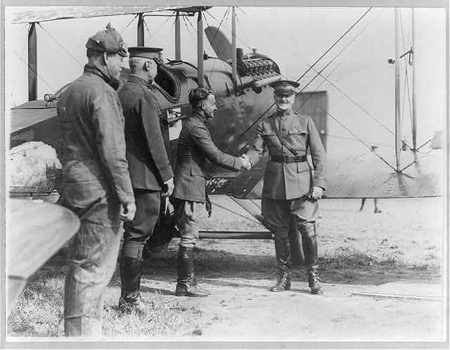 16 x 20 Reprinted Old Photo of Reception of the Alaskan flyers at Washington, D.C. - Gen. Pershing congratulating Capt. Street of the squadron [alongside airplane, as [ca. 1928] National Photo Co  71a