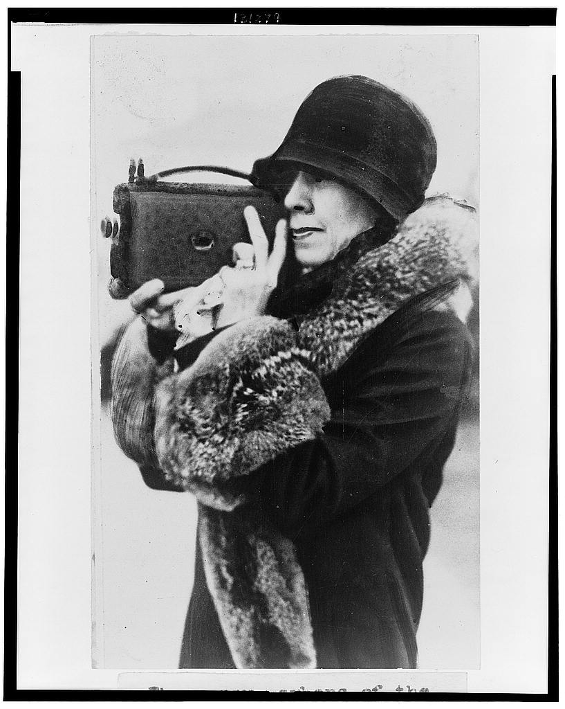 8 x 10 Reprinted Old Photo of [Mrs. Coolidge, member of the White House News Photographers Association, half-length portrait, standing, facing left, holding camera up to fa 1929 National Photo Co  98a
