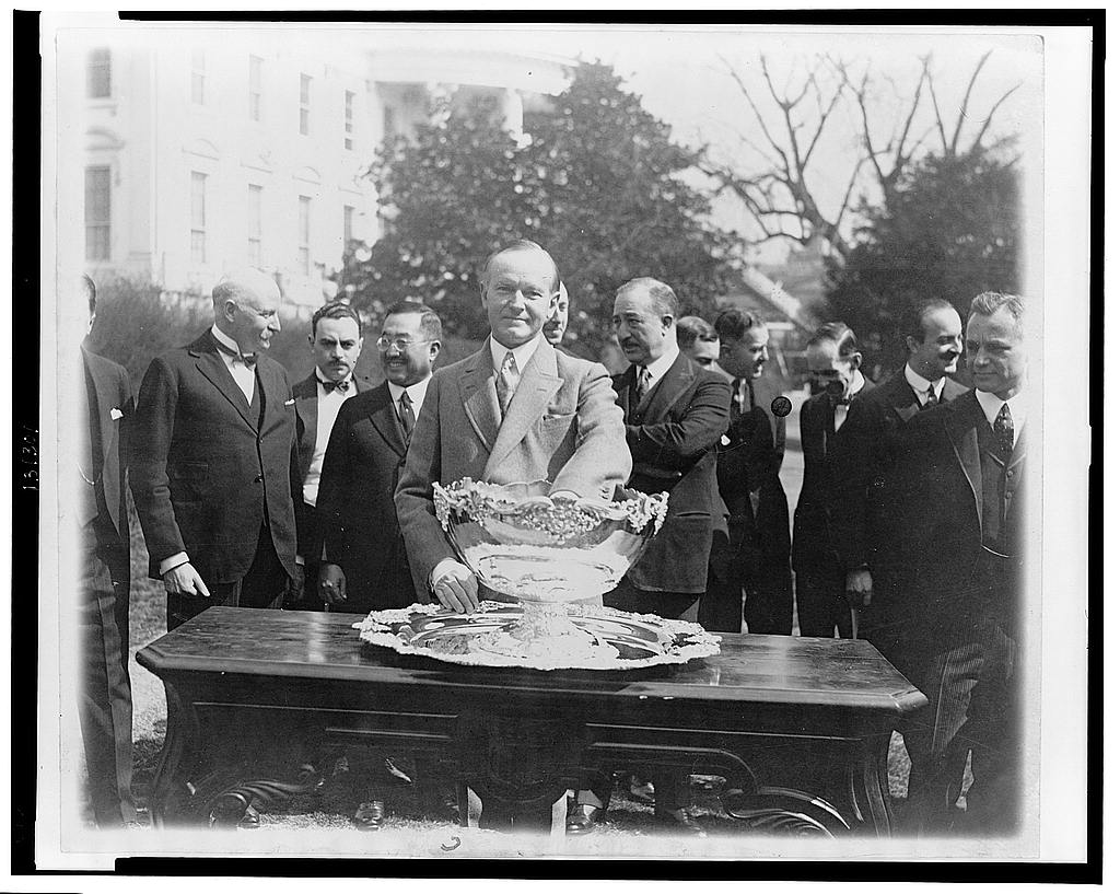 8 x 10 Reprinted Old Photo of President Coolidge makes tennis draw at White House--Drawing for the Davis Tenni[s] matches was held at the White House with practically all o 1927 National Photo Co  24a