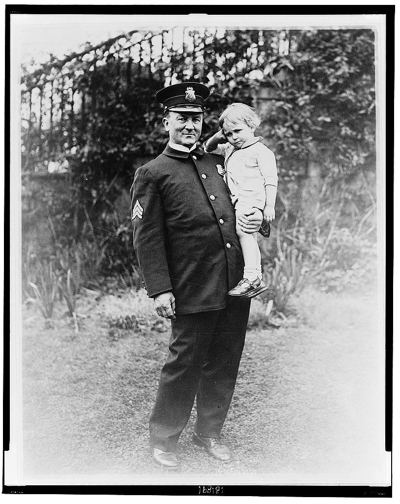 8 x 10 Reprinted Old Photo of [Sgt. McQuade, White House Policeman, holding a lost child] 1922 National Photo Co  55a