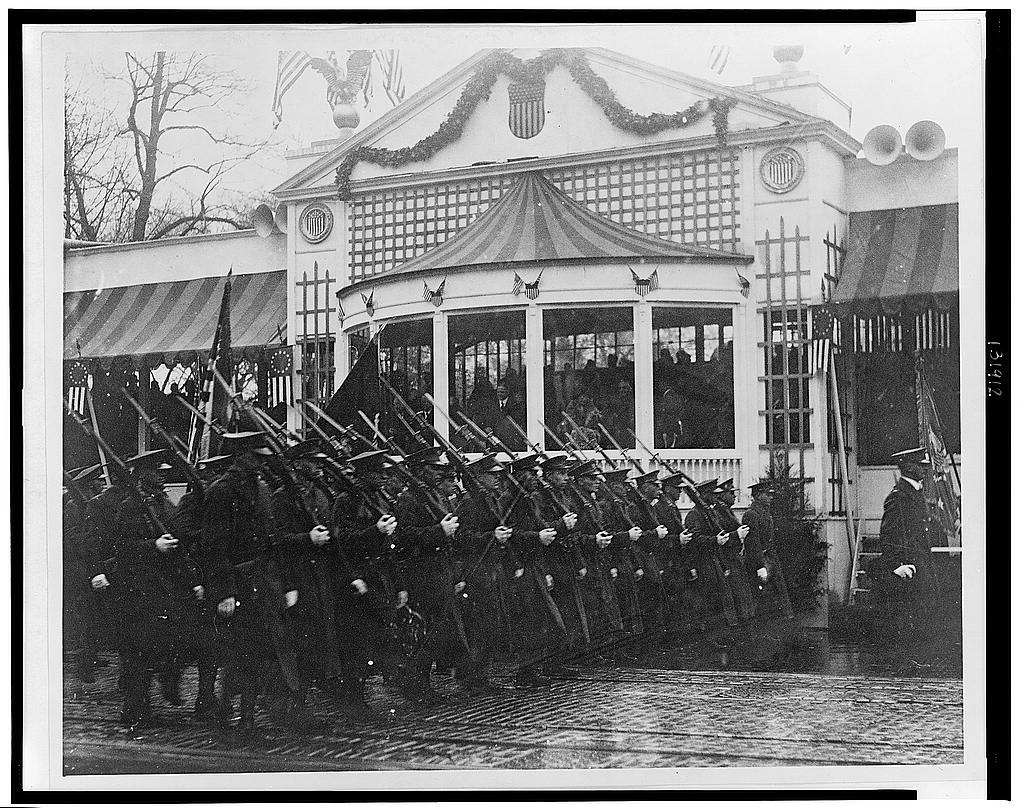 8 x 10 Reprinted Old Photo of [President Hoover and Mrs. Hoover standing in reviewing stand, watching soldiers march by during Hoover's inaugural parade] 1929 National Photo Co  38a
