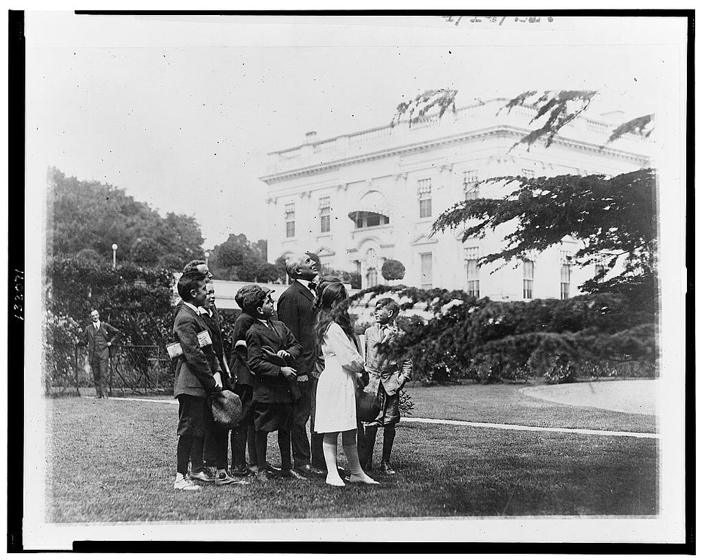 8 x 10 Reprinted Old Photo of Pointing out an owls nest in the White House grounds to members of the nature study class of John Buroughs [sic] School whom he invited to the 1921 National Photo Co  09a