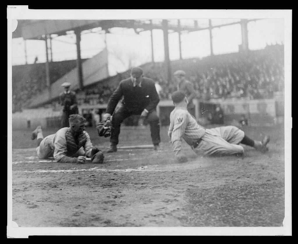 8 x 10 Reprinted Old Photo of [Waiting for the umpire to make the call as Washington ball player, Joe Judge, slides across home plate, the catcher, on the left, is lying on 1921 National Photo Co  12a